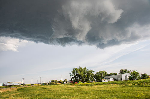 funnel cloud above homes