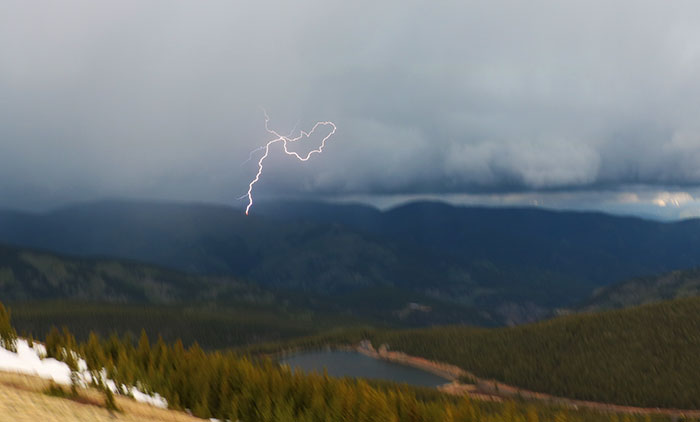 Lightning from the mountain storm that spun the tornado