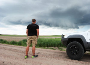 storm chaser watching a storm